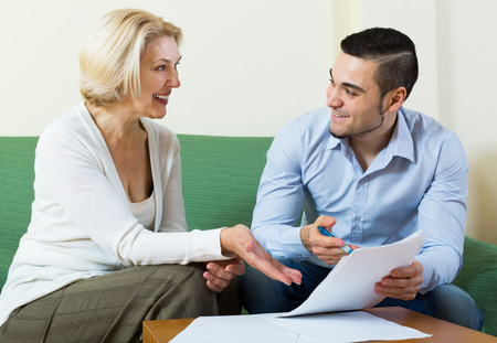 gigolo: Difficulties of communication between adult son and senior mother Stock Photo