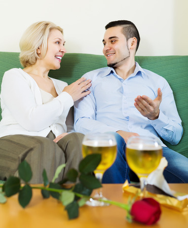 Happy mature woman with young boyfriend having date Stock Photo