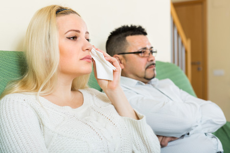 bereavement: Sad married couple having problems at home