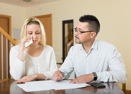 financial problems: Husband and despair wife having a financial problems