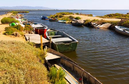ebre: Fishing boats at delta of Ebro river in summer. Catalonia, Spain