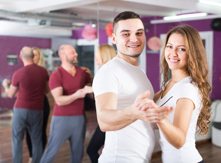 38288147: many young people having dancing class indoors