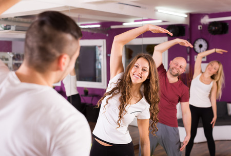 limbering: Group of people men and women limbering up in a gym Stock Photo