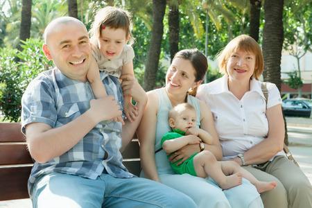 three generation: Happy three generations family in summer park