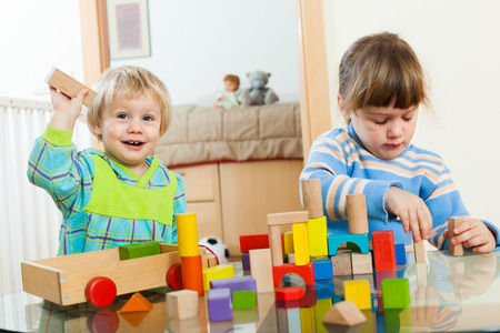 2 3 years: Two siblings together playing with toys Stock Photo