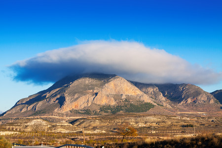 lenticular cloud: Cerro Jabalcon mount and Lenticular cloud near Baza.  Spain