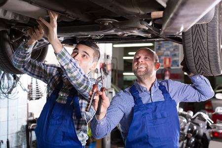 mounting holes: Positive russian mechanics fixing car tire leak