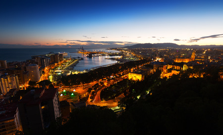 Evening view of  Malaga with Port and Placa de Torros from castle.   Spain photo