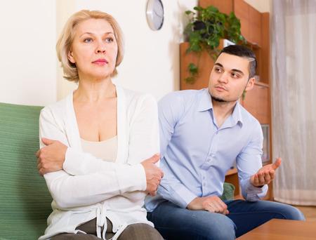Domestic quarrel between adult son and senior mature mother