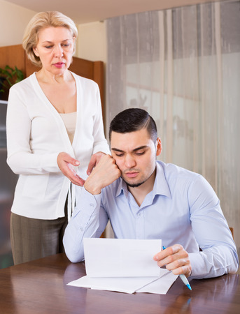 Financial crisis in family of adult son and senior mother