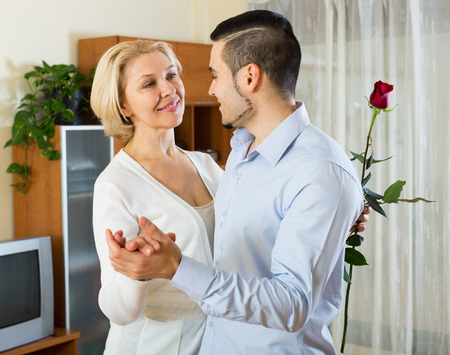mismatch: Russian son asking senior mother to dance at home