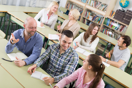 adult students: Russian professionals taking notes at training session for employees Stock Photo