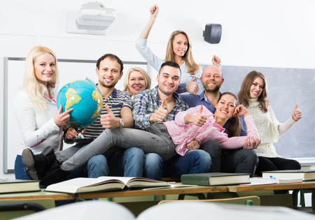 cohesive: Positive professor and group of students at extension courses
