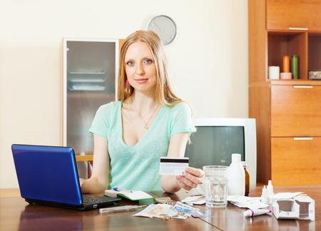 Blonde   girl choosing medication in online pharmacy at home