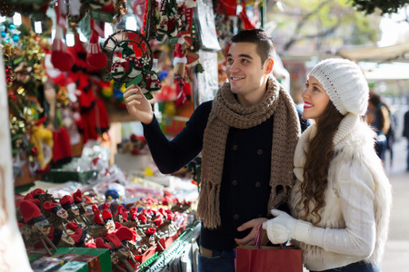 Happy  couple  choosing Christmas souvenirs at Barcelona Stock Photo