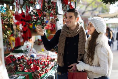 family shopping: Happy  couple  choosing Christmas souvenirs at Barcelona Stock Photo