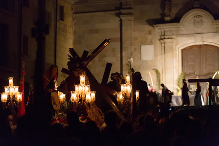 processions: BADALONA, SPAIN - APRIL 2, 2015: Evening procession during Holy Week in Badalona. Semana Santa or Holy Week is Christian  processions on  streets of Spanish cities and town