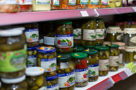 BARCELONA, SPAIN - MARCH 22, 2015: Shelves with canned goods at groceries section of average Polish supermarket in Barcelona.
