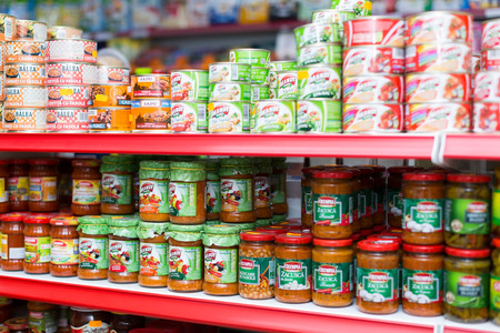 BARCELONA, SPAIN - MARCH 22, 2015: Shelves with canned goods at groceries section of average Polish supermarket 에디토리얼