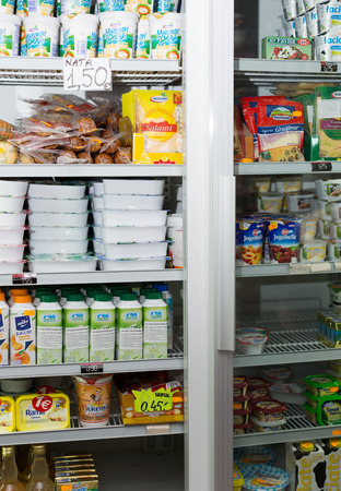 BARCELONA, SPAIN - MARCH 22, 2015: Refrigerator shelves with different chilled products, such as butter and milk, at average Polish supermarket in Barcelona.