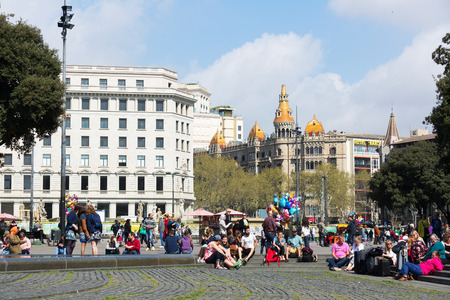 avenues: BARCELONA, SPAIN - APRIL  5, 2015:  Catalonia Square in spring day. Barcelona, Catalonia.  Some of most important streets and avenues meet at here. Center of business and cultural life Editorial