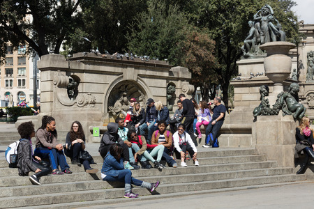 avenues: BARCELONA, SPAIN - APRIL  5, 2015:  Young people in Catalonia Square in sunny day. Barcelona, Catalonia.  Some of most important streets and avenues meet at here. Center of business and cultural life