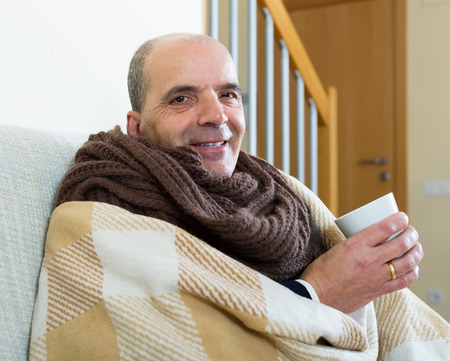 linctus: Portrait of sick elderly man being treated for cold Stock Photo