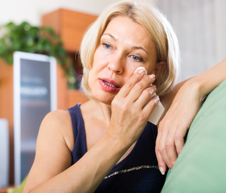 Mature blonde on couch