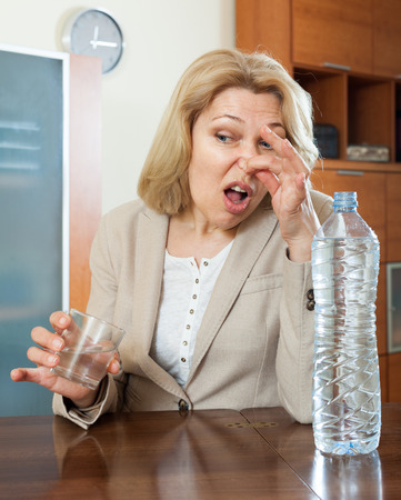 mature woman with  poor quality water at home