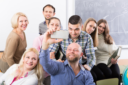 cohesive: Happy professionals and coach making group portrait at the school Stock Photo