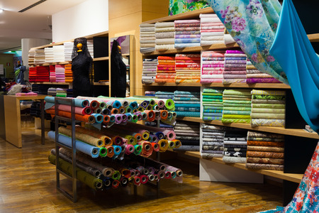 various textiles for sale in fabric shop 스톡 콘텐츠