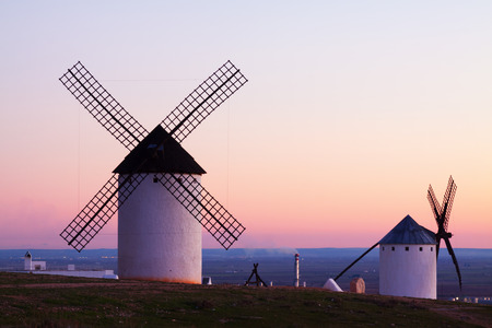 wind mills: Wind mills at Campo de Criptana in evening Stock Photo
