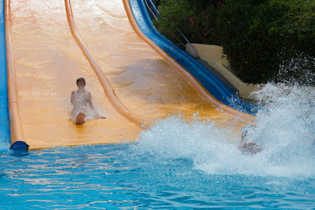 water park: BARCELONA, SPAIN - AUGUST 30, 2014: Women on water slide at Water Park in summer
