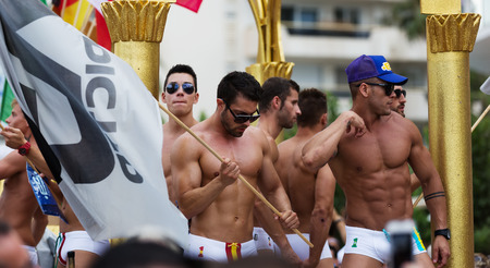gay parade: SITGES, SPAIN - JUNE 15, 2014: Guys at procession in  Gay pride parade in Sitges