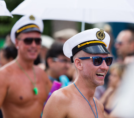 flatfoot: SITGES, SPAIN - JUNE 15, 2014: Men dressed as sailors  at Gay pride parade in Sitges Editorial