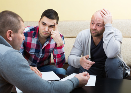 financial issues: Three men discussing financial issues