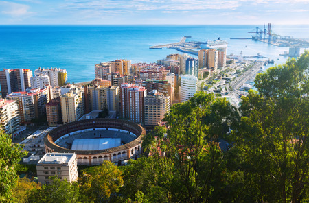 toros: Day view of Malaga with Port and Placa de Torros from castle.  Andalusia, Spain