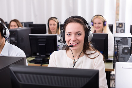 workplace wellness: Working process of successful call center team at office and young woman Stock Photo