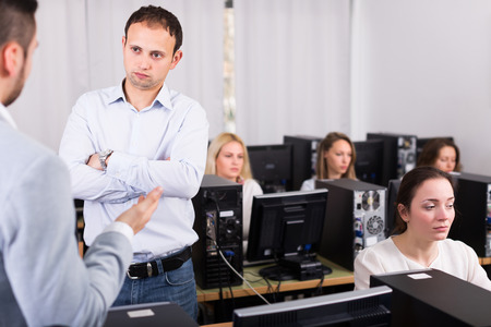strict: Strict boss and clerk at open space working area Stock Photo