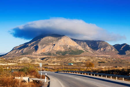 lenticular: Cerro Jabalcon mount and Lenticular cloud near Baza. Andalusia, Spain Stock Photo