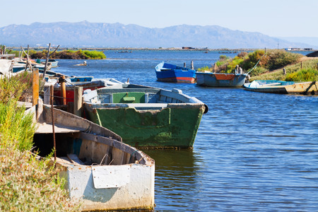 ebre: Old fishing boats at delta of Ebro river in summer day.  Spain