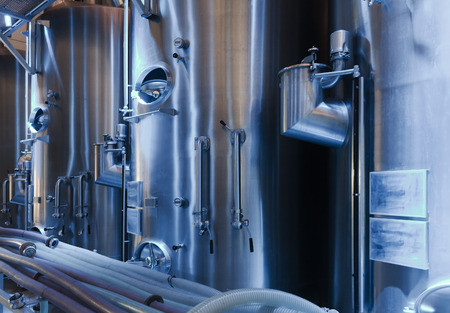 winemaker: stell barrels in interior of contemporary winemaker