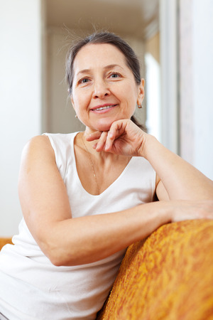 casualy: Portrait of  beauty mature woman in home interior Stock Photo