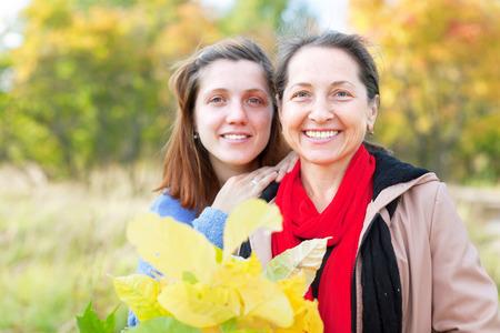 2 50: Outdoor portrait of women in autumn  park Stock Photo