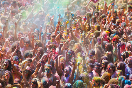colores: BARCELONA, SPAIN - APRIL 12, 2015: People at  Festival de los colores Holi. Holi is traditional holiday of India