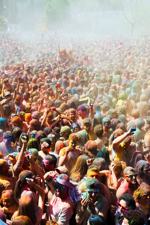 trituration: BARCELONA, SPAIN - APRIL 12, 2015: Many  dirty people at Festival de los colores Holy at Barcelona. It is traditional holiday  of Indian culture