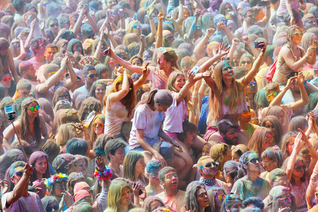 colores: BARCELONA, SPAIN - APRIL 12, 2015: Happy people at  Festival de los colores Holi in Barcelona. Holi is traditional holiday of India