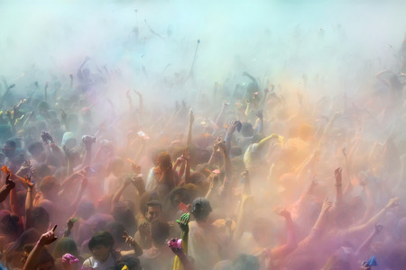 trituration: BARCELONA, SPAIN - APRIL 12, 2015: Dirty people during   Festival of colours Holy at Barcelona. Holi is traditional holiday of India