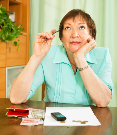 worrying: Female pensioner worrying about their money situation Stock Photo