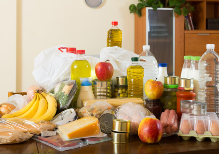 foodie: Still life with foodstuffs of supermarket on table in  interior